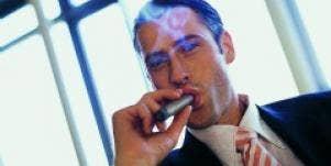 Smarmy man with a cigar