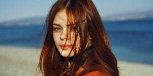 redheaded woman at the beach