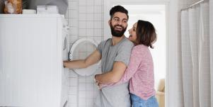 man and woman doing laundry