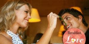 couple feeding each other restaurant