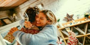 man and woman toasting at holidays