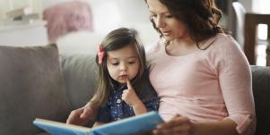 kid and mom reading