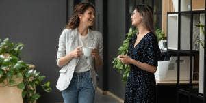 two office women talkin
