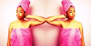 woman in towel wondering why her vagina smells like bleach