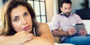 upset woman with man on his ipad