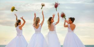 brides throwing bouquets in air