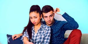 woman next to man who's acting distant and pulling away