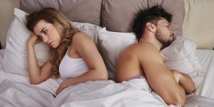 woman and man in opposite directions in bed