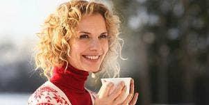 woman drinking coffee outside