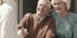 woman shaking hands with elderly couple