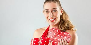woman opening valentine's day gift