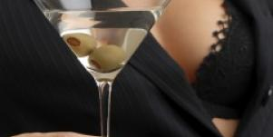 Sexy woman holding Martini