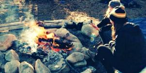 couple sitting around campfire
