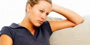 grumpy woman on sofa