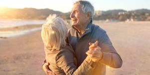 Older Couple Dancing On The Beach