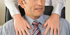 man with hands on shoulder