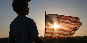 little boy holding a flag
