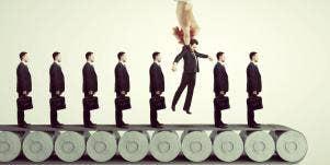 men on conveyor belt