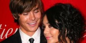 Zac Efron and Vanessa Hudgens pose together.