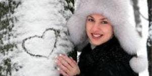 winter woman snow heart on tree