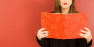woman reading journal