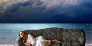 Woman sleeping on a couch on the beach